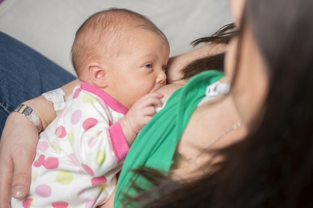a mom breastfeeding her baby