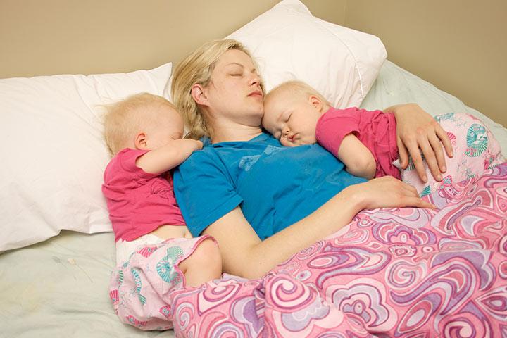 how to put twins to sleep