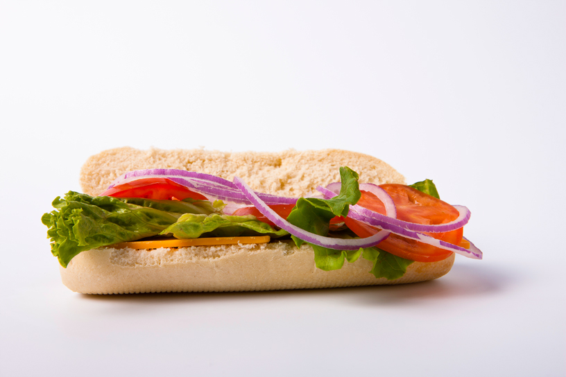 sandwich with lettuce, tomato, onions and cheese